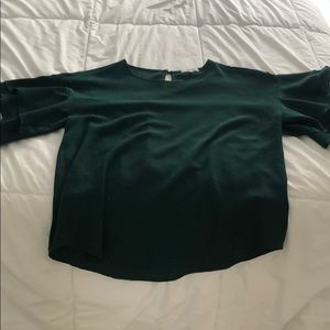 Green blouse with ruffled sleeves